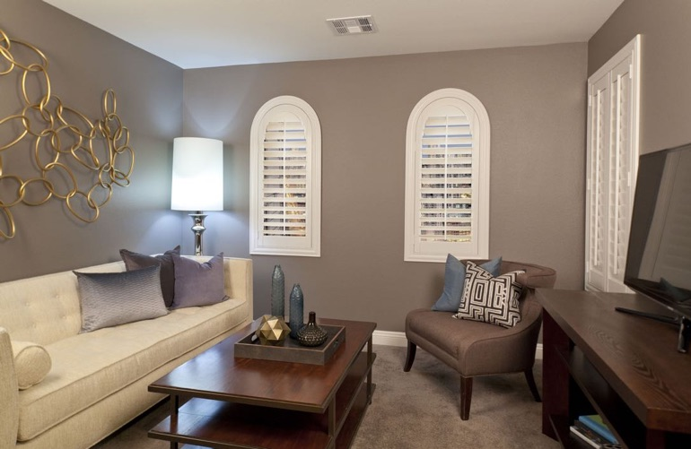 Cincinnati family room with rounded plantation shutters.