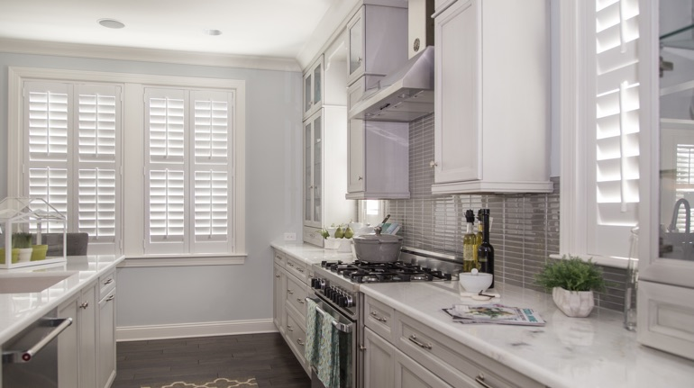 Polywood shutters in Cincinnati kitchen with marble counter.