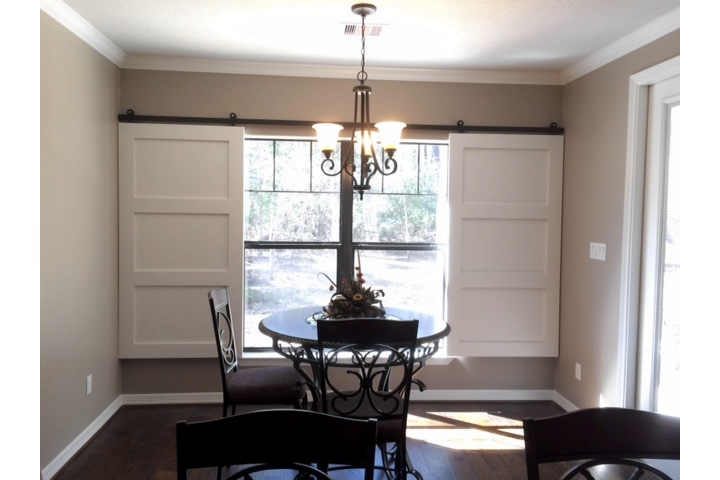 Cincinnati dining room with sliding barn door shutters.