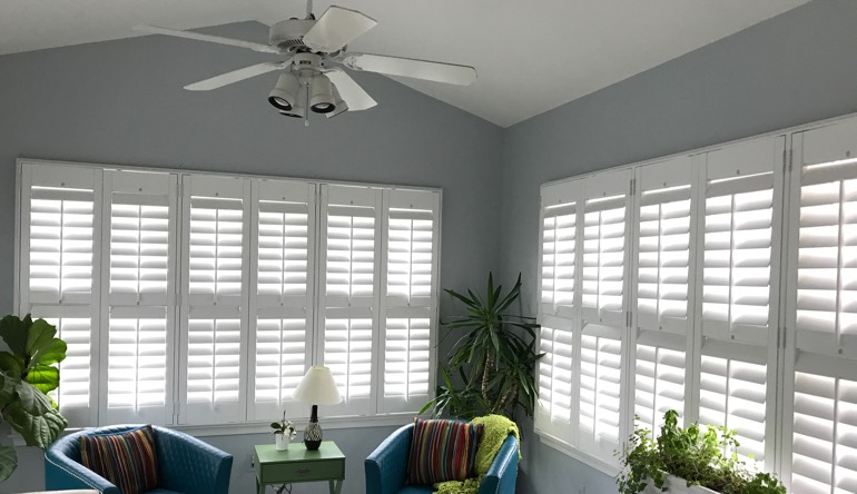 Cincinnati living room with fan and shutters