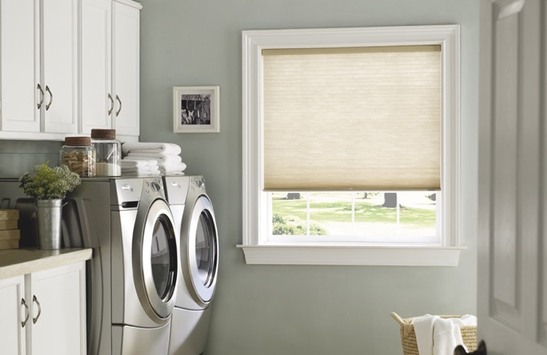 Cincinnati laundry room with beige window shades.