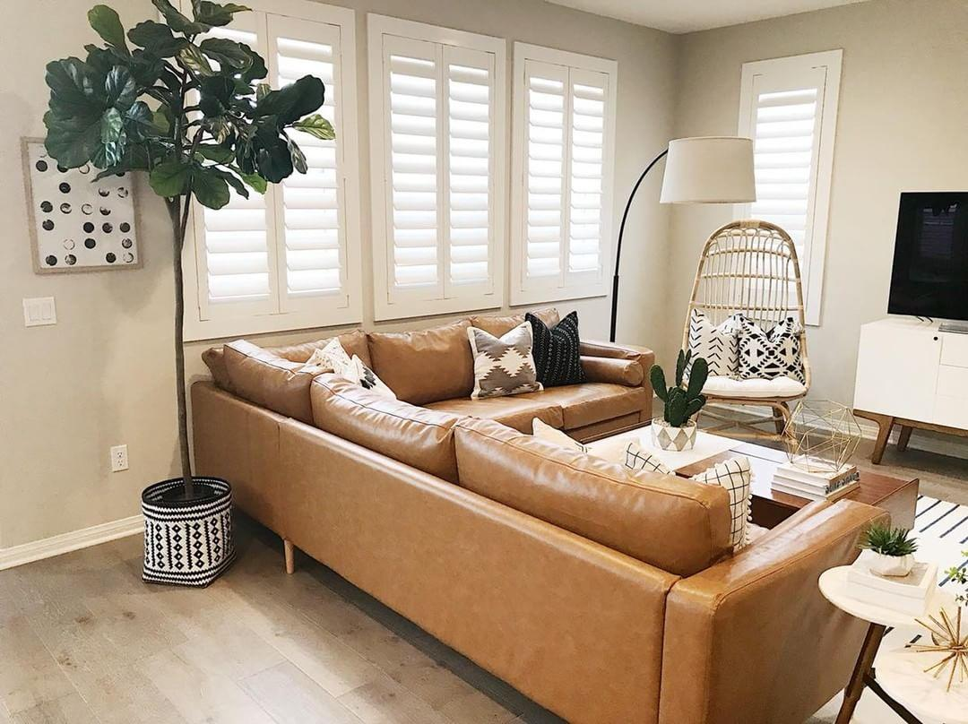 Warm living room with Polywood shutters in Cincinnati.