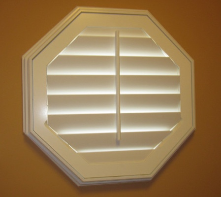 Cincinnati octagon window with white shutter