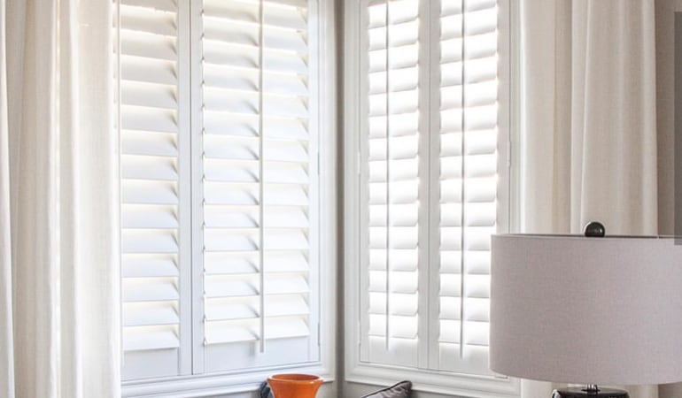 Plantation shutters in a corner window.