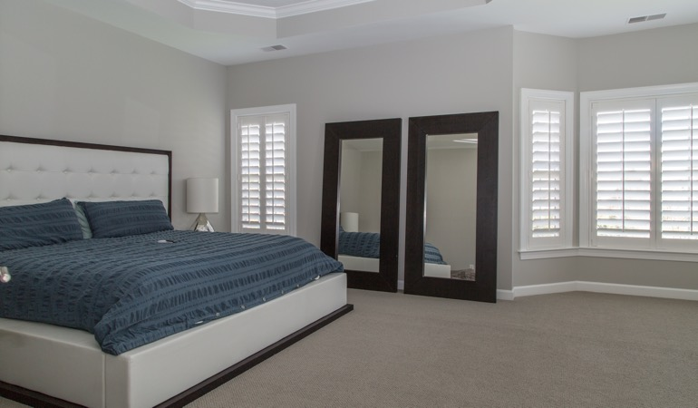 White shutters in a minimalist bedroom in Cincinnati.