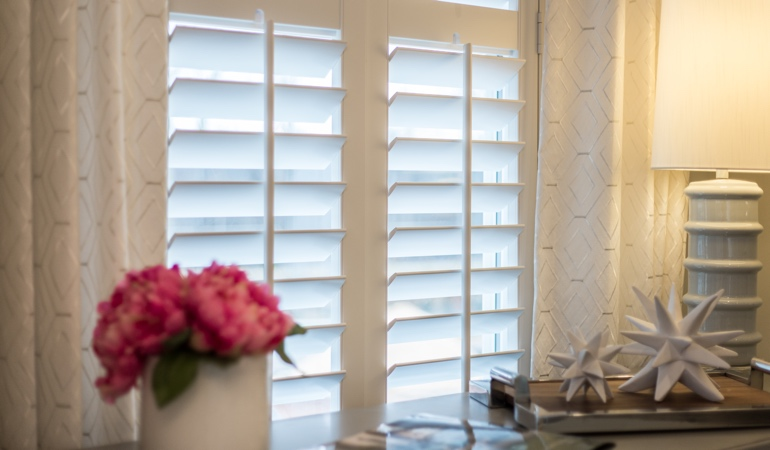 Plantation shutters by flowers in Cincinnati