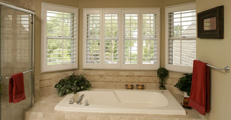 Plantation shutters in Cincinnati bathroom.