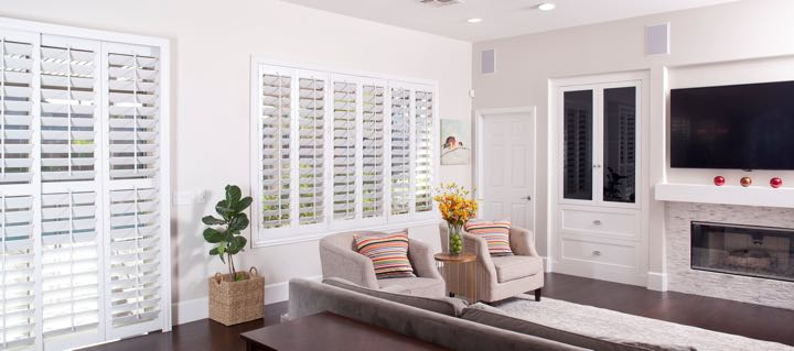 Cincinnati living room in white with plantation shutters.