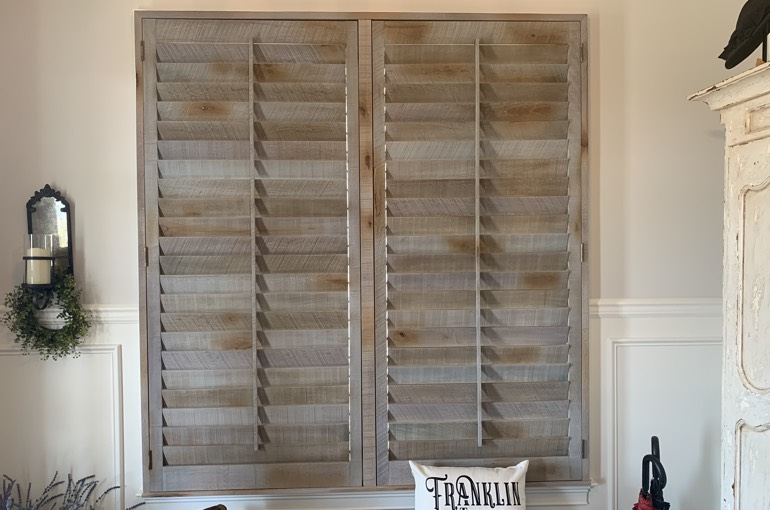 Reclaimed wood shutters over bench