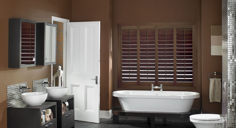 Stained wood shutter in Cincinnati bathroom