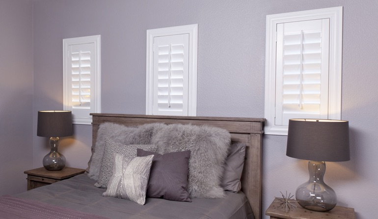 Classic plantation shutters in Cincinnati bedroom windows.