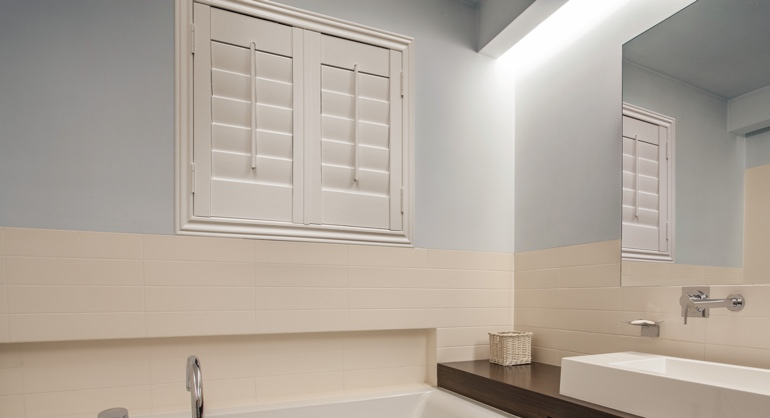 Plantation waterproof shutters in Cincinnati bathroom.