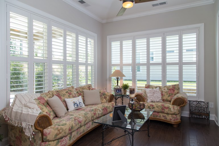 Traditional sunroom with plantation shutters in Cincinnati.