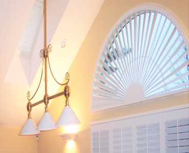 Cincinnati arched eyebrow window with classic shutter