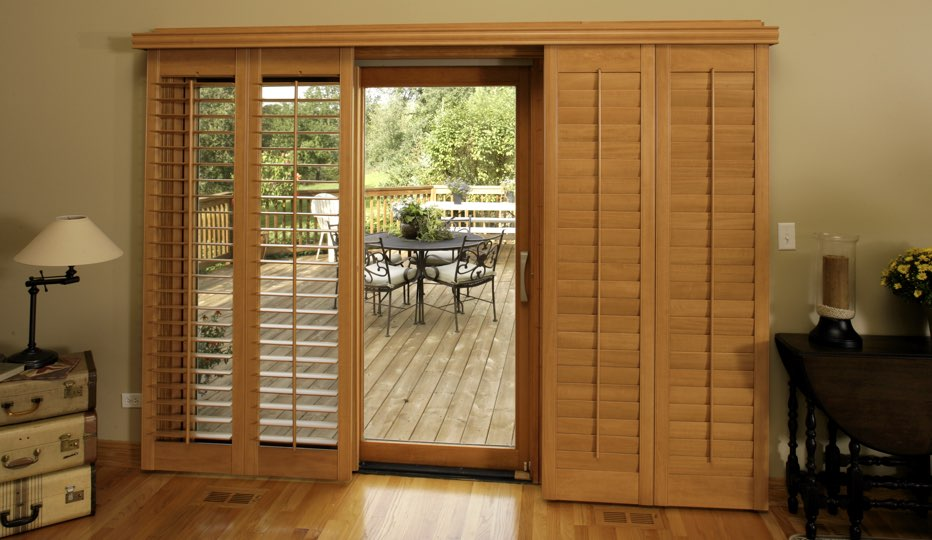 Wood bypass patio door shutters in Cincinnati living room