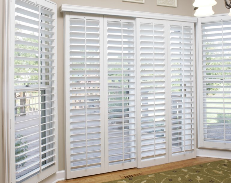 Sliding glass door with white shutters Cincinnati