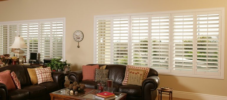 Wide window with plantation shutters in Cincinnati living room
